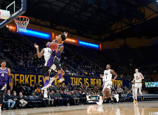 Washington guard David Crisp drives to the basket against California guard Paris Austin (3) during the first half of an NCAA college basketball game Thursday, Feb. 28, 2019, in Berkeley, Calif.