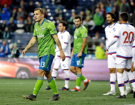 Seattle Sounders forward Jordan Morris, left, walks on the pitch after the ball went out of bounds during the second half of the team's exhibition soccer match against Club Nacional, Wednesday, Feb. 20, 2019, in Seattle. Club Nacional won 2-0.