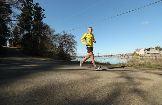 Peter Vosshall runs down Bainbridge Island's Point Monroe Drive. Vosshall has run 10 Boston Marathons and is training for his 11th this spring.