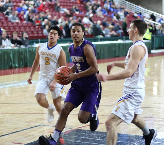 North Kitsap's Kobe McMillian drives to the basket during Friday's Class 2A state tournament game against Fife.