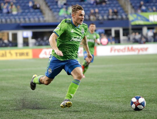 Seattle Sounders forward Jordan Morris drives against Club Nacional during the second half of an exhibition soccer match Wednesday, Feb. 20, 2019, in Seattle. Club Nacional won 2-0.