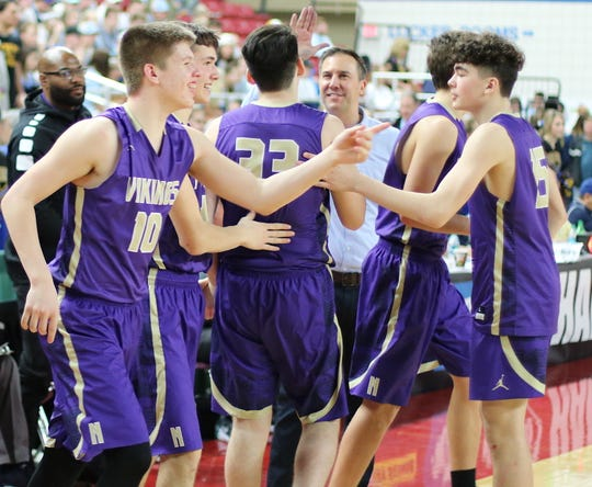 North Kitsap coach Scott Orness and players celebrate after Friday's victory over Fife at the Class 2A state tournament.