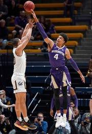 Washington guard Matisse Thybulle (4) blocks a shot by California guard Matt Bradley (20) during the first half of an NCAA college basketball game Thursday, Feb. 28, 2019, in Berkeley, Calif.