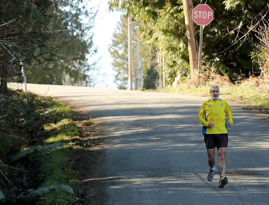 Peter Vosshall runs down Bainbridge Island's Point Monroe Drive. Vosshall managed to run every road in Bainbridge Island, and it took him 52 hours over the course of about nine weeks.