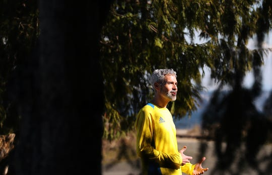 Peter Vosshall talks about his street running project before a run at Fay Bainbridge Park. Vosshall made it his goal this year to run every street on the island, and he accomplished it over the weekend.