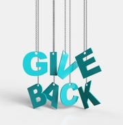 Give Back hanging on chain