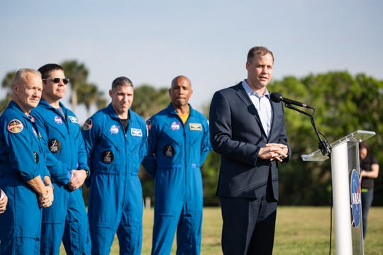 NASA Administrator Jim Bridenstine speaks during a SpaceX Crew Dragon pre-launch briefing at Kennedy Space Center. He is joined by astronauts Doug Hurley, Bob Behnken, Mike Hopkins and Victor Glover.