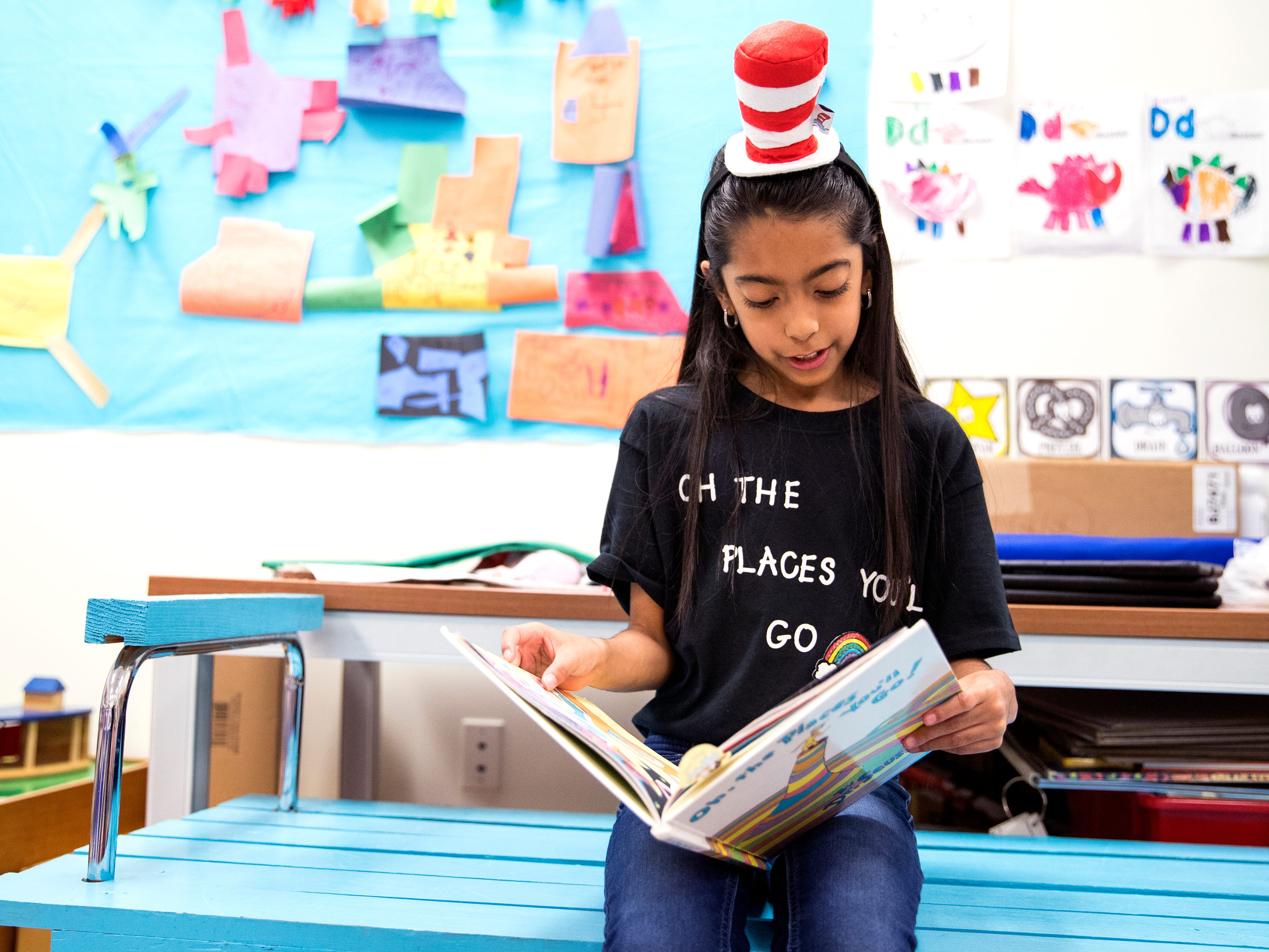 School of Science and Technology student and reading club member Isabella Bass, 8, read to pre-kindergarten students during the school's Dr. Seuss's Birthday and Read Across America event on Friday, March 1, 2019.