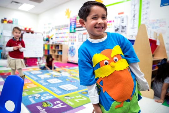 School of Science and Technology student Evan Deleon, 4, was decked out as The Lorax for the school's Dr. Seuss's Birthday and Read Across America event on Friday, March 1, 2019. Students from the reading club visited the pre-kindergarten class and read to the class in small groups.