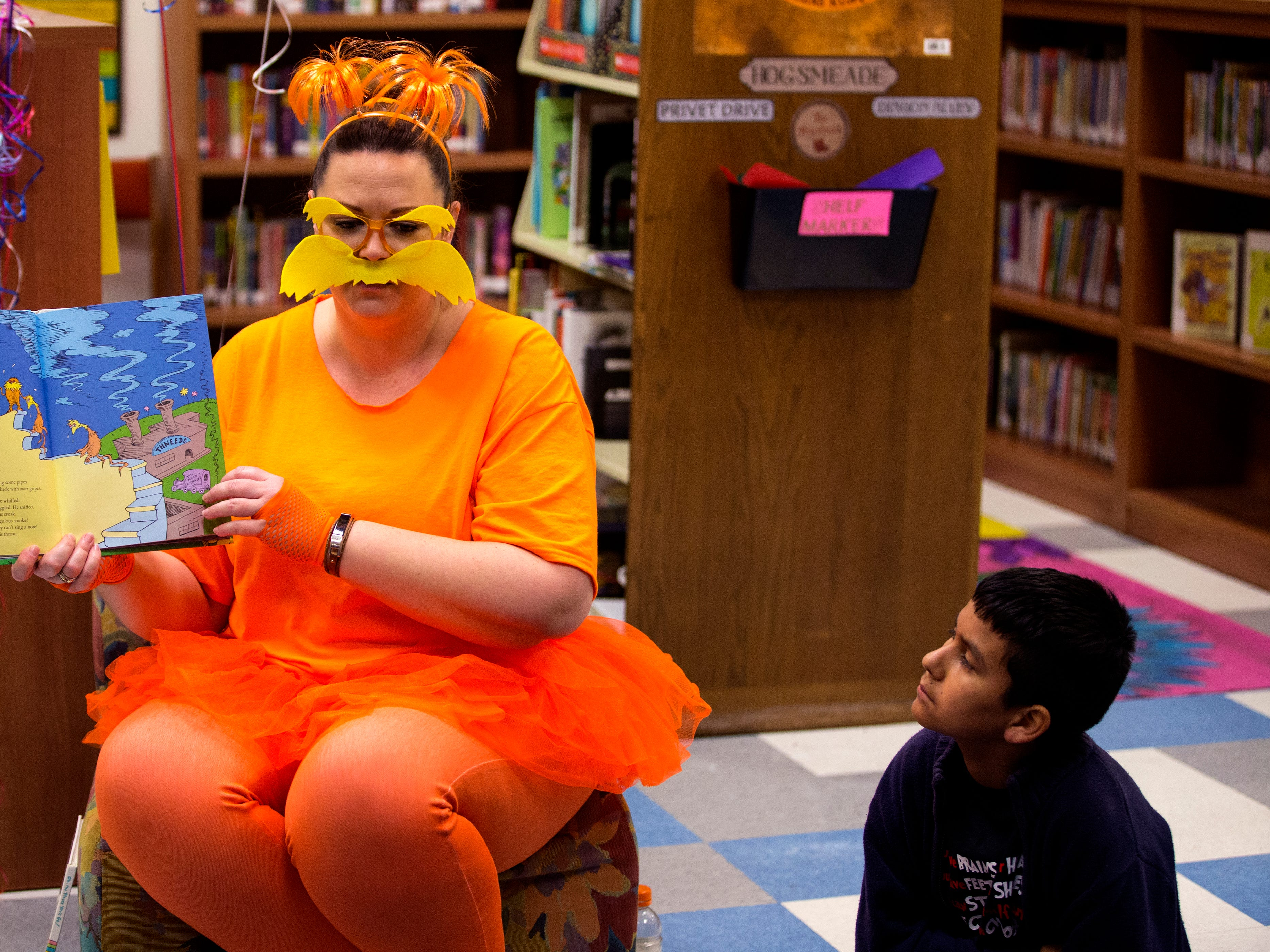 "School of Science and Technology librarian Tara Reed reads ""The Lorax"" to students, including Daniel Cortez (right) during a Dr. Seuss's Birthday and Read Across America event on Friday, March 1, 2019."