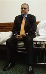 Mario Gallegos on his hospital bed outside of the Texas Senate chamber in May 2007.