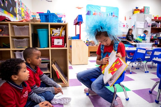 School of Science and Technology students Shemar Palmer (from left), 4, and Kailand Lott, 5, listen as reading club member Rivianna Volkman, 7, reads to them during the school's Dr. Seuss's Birthday and Read Across America event on Friday, March 1, 2019. Students from the reading club visited the pre-kindergarten class and read to the class in small groups.