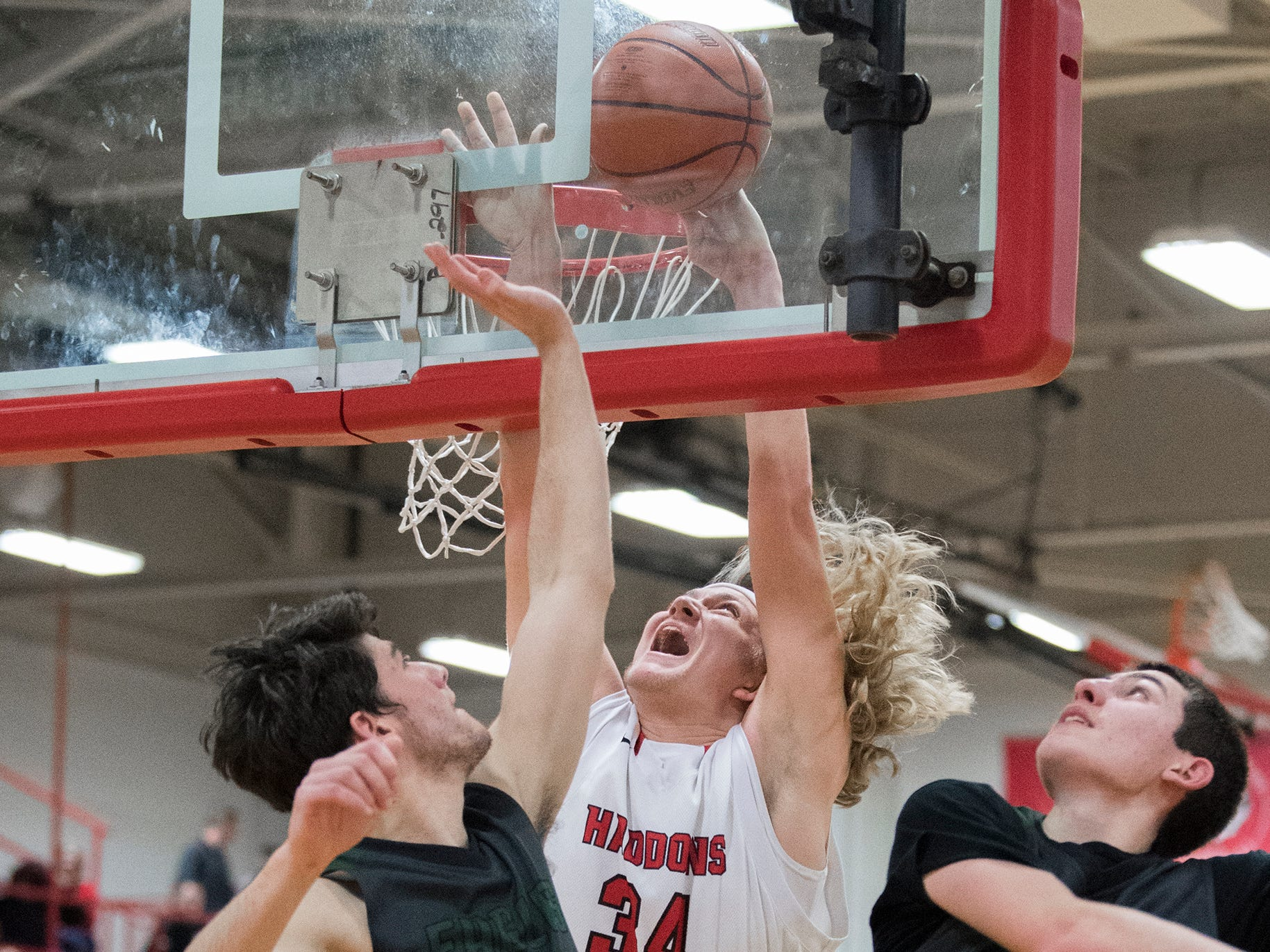 Haddonfield's Dylan Heine (34) attempts a basket against West Deptford Friday, March 1, 2019 at Cherry Hill High School East in Cherry Hill, N.J. Haddonfield won 51-30.