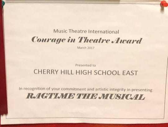 An award from Music Theatre International recognized Cherry Hill High School East with persevering with a performance of 'Ragtime' despite a controversy over the use of the N-word. Theater director Tom Weaver said the 'sting' of the word is a teaching tool for students.