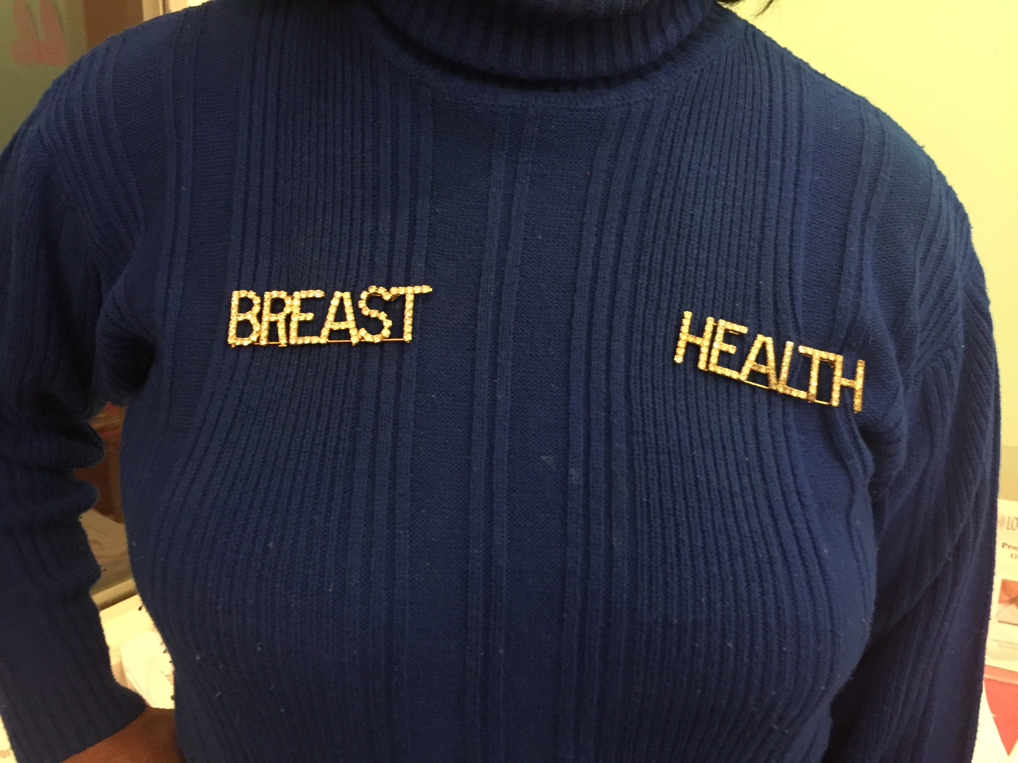 """Dorothea Atkinson's """"breast health"""" pins put her message front and center at the Courier-Post's second annual Galentine's Day event at The Pop Shoppe in Collingswood on Thursday, Feb. 28, 2019."""