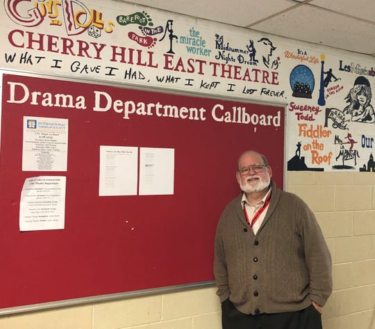 Tom Weaver, director of the theater program at Cherry Hill High School East, stands under one his favorite quotes: 'What I gave I had, what I kept I lost forever.'