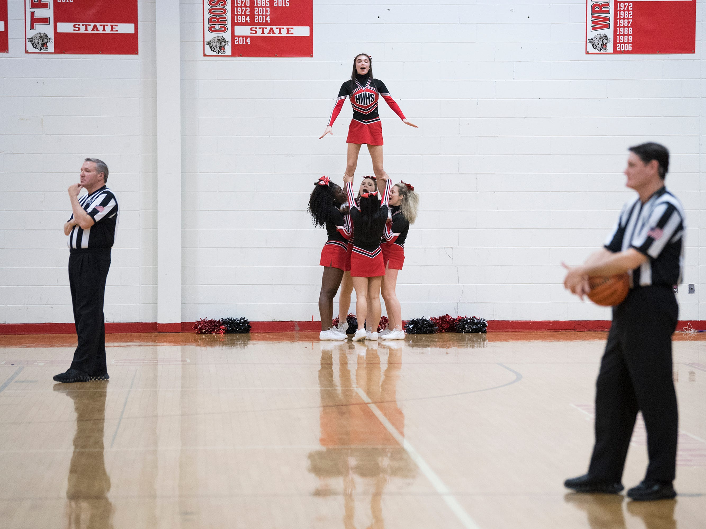 Haddonfield cheerleaders perform during a game against West Deptford Friday, March 1, 2019 at Cherry Hill High School East in Cherry Hill, N.J. Haddonfield won 51-30.