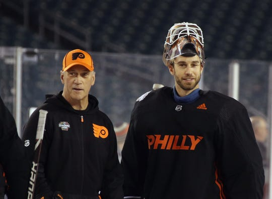 Cam Talbot, right, had been with the Flyers for nearly two weeks before he got a start Friday night against the New Jersey Devils.