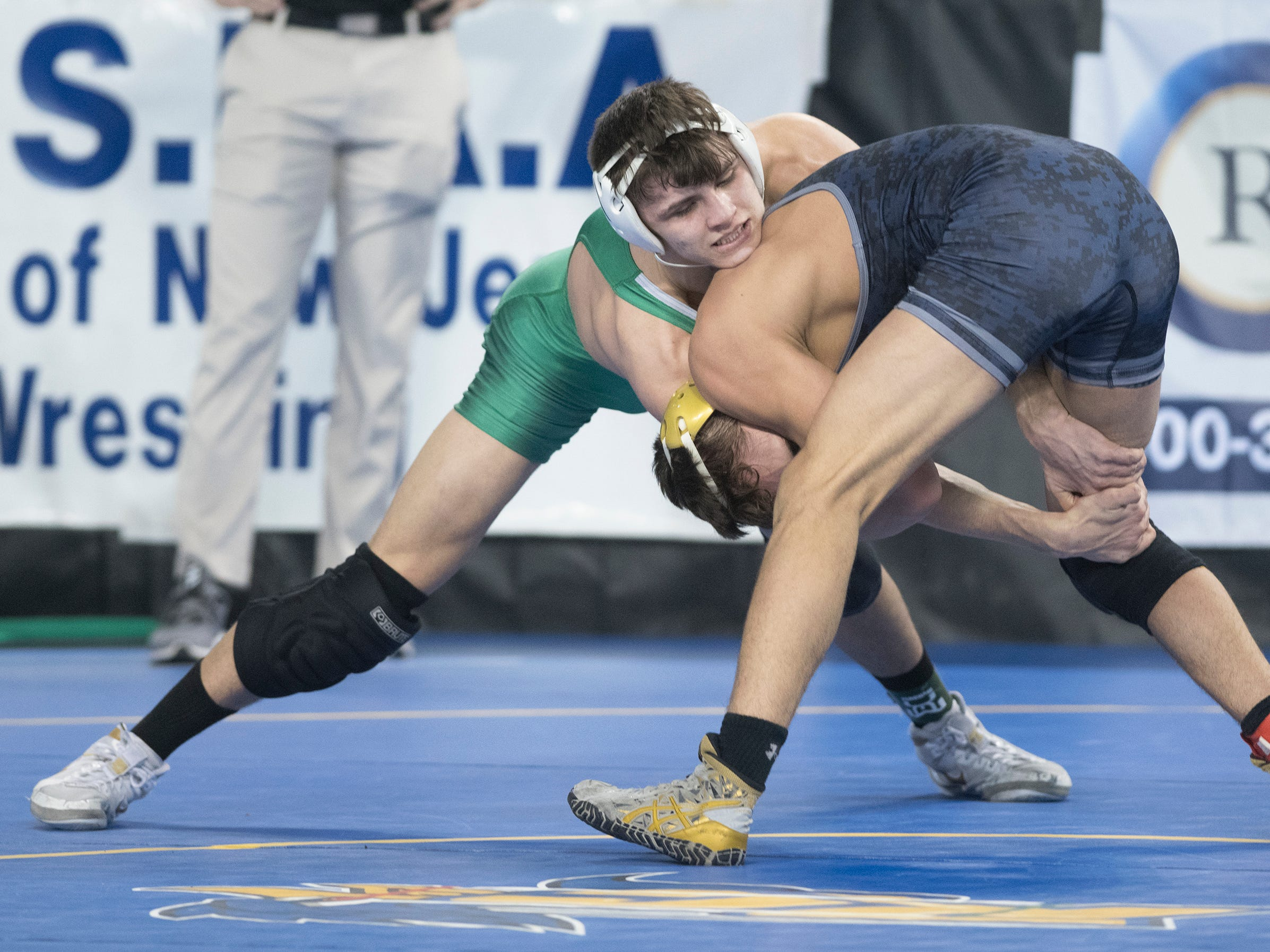 West Deptford's Corey Fischer, left, battles Clayton/Glassboro's Jacob Rodriguez for a take down during a 160 lb. pre-quarterfinal round bout during the 2019 NJSIAA State Wrestling Championships tournament held at Boardwalk Hall in Atlantic City on Thursday, February 28, 2019.  Fischer won, 5-1.