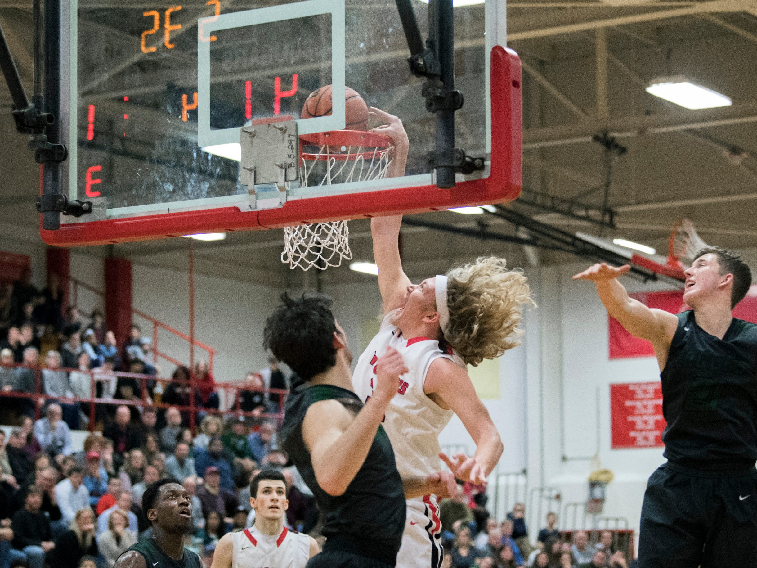 Haddonfield's Dylan Heine (34) dunks over West Deptford Friday, March 1, 2019 at Cherry Hill High School East in Cherry Hill, N.J. Haddonfield won 51-30.