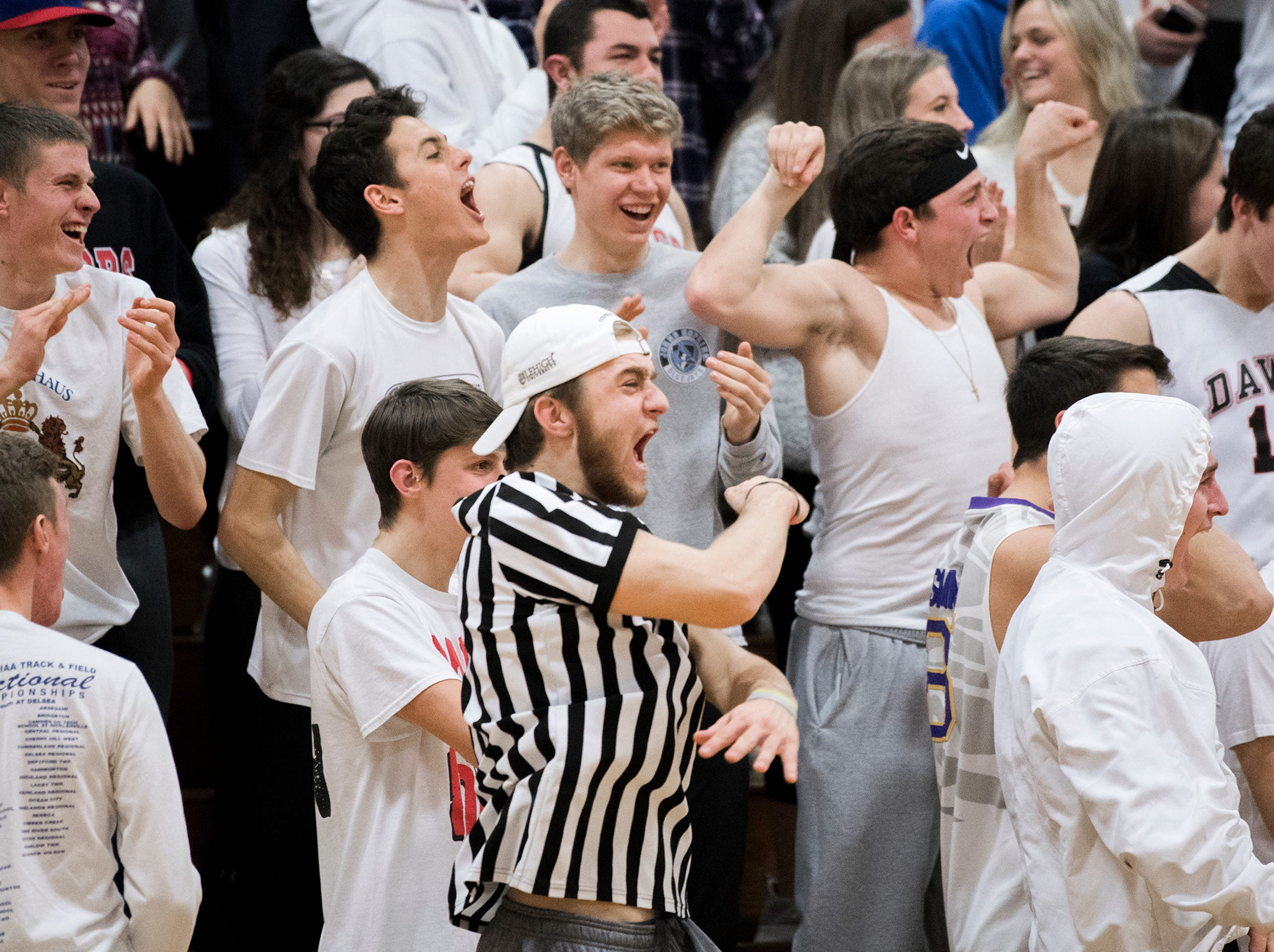 Haddonfield fans erupt following Dylan Heine's dunk Friday, March 1, 2019 against West Deptford at Cherry Hill High School East in Cherry Hill, N.J. Haddonfield won 51-30.