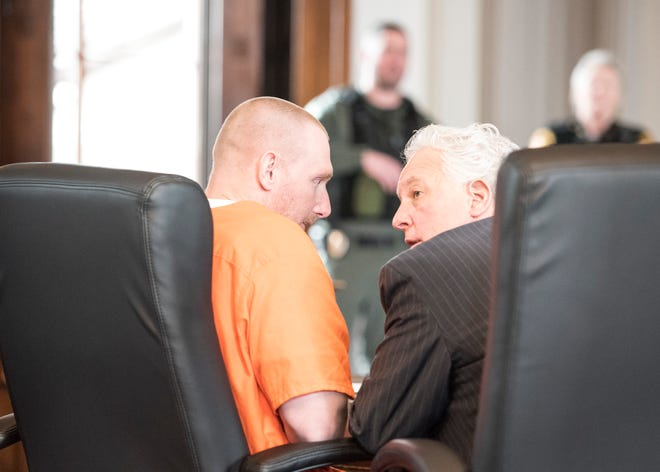 "Jesse Hanes talks with his attorney Kirk McVay after being arraigned in Ross County Common Pleas Court on capital murder charges for the 2016 shooting death of Theodore ""Ted"" Timmons."