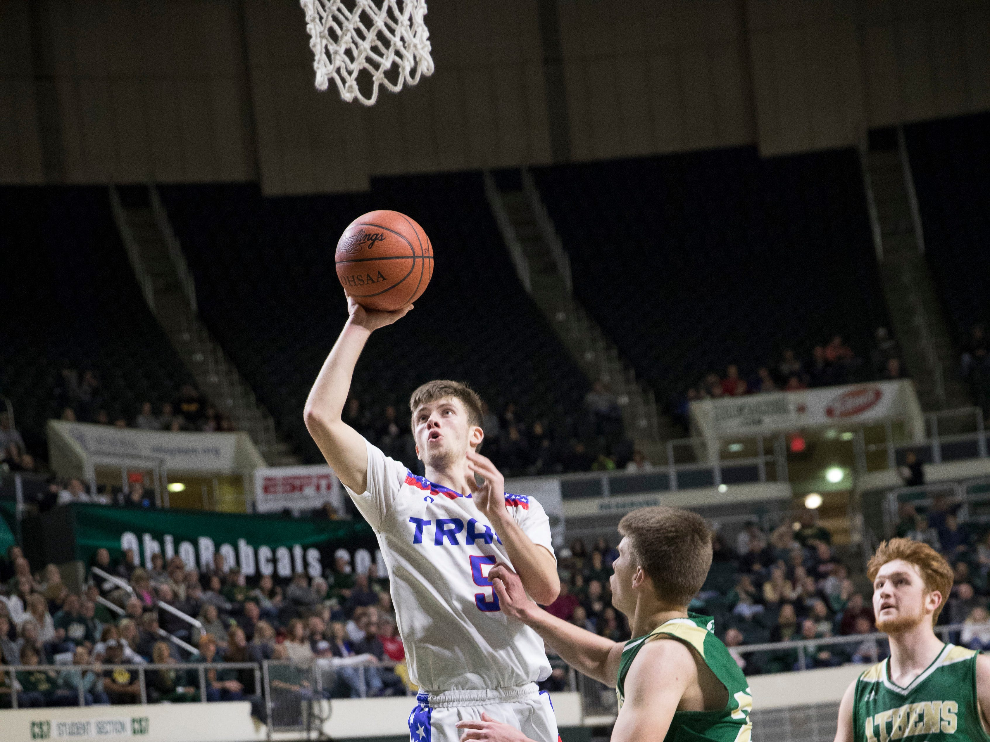 Nick Nesser shoots it over Athens defender at Ohio University's Convocation Center in the Division II District Semifinals on Thursday. Zane Trace defeated the Bulldogs 48-28.