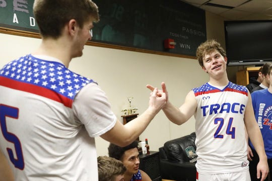 Zane Trace teammates Chad Ison and Nick Nesser celebrate after 48-28 district semifinal win over Athens on Thursday Feb. 28.