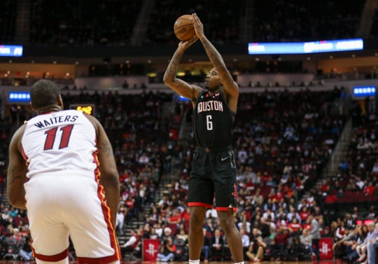 Houston Rockets forward Gary Clark (6) shoots the ball as Miami Heat guard Dion Waiters (11) looks on during the first quarter at Toyota Center on Feb. 28.