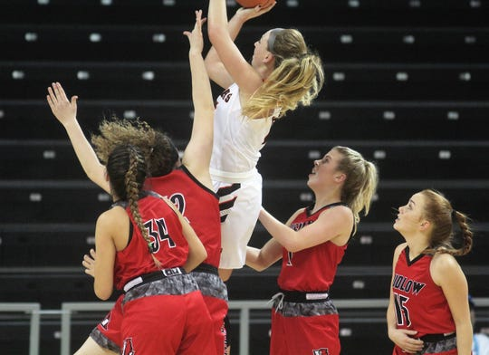 Ryle senior Lauren Schwartz skies to make a shot as Ryle defeated Ludlow 60-26 in the quarterfinals of the KHSAA Ninth Region girls basketball tournament Feb. 28, 2019 at NKU's BB&T Arena, Highland Heights Ky.