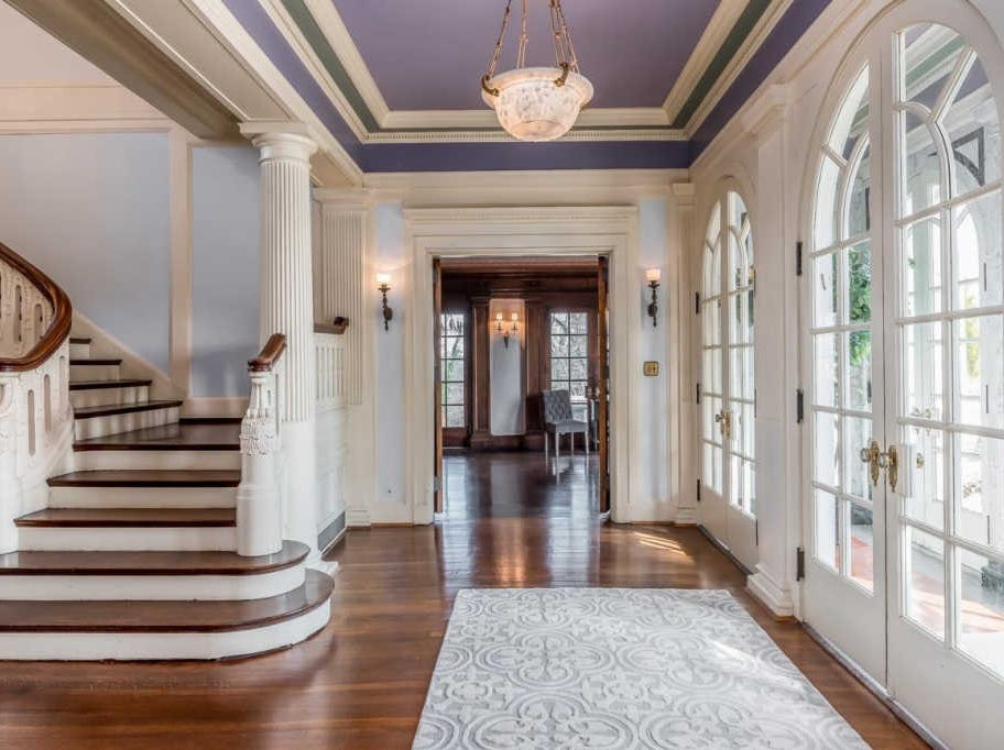 Sitting on just under 11 acres, the home features a grand carved oak staircase, English Wedgwood door knobs, detailed millwork and an Italian marble vestibule entry
