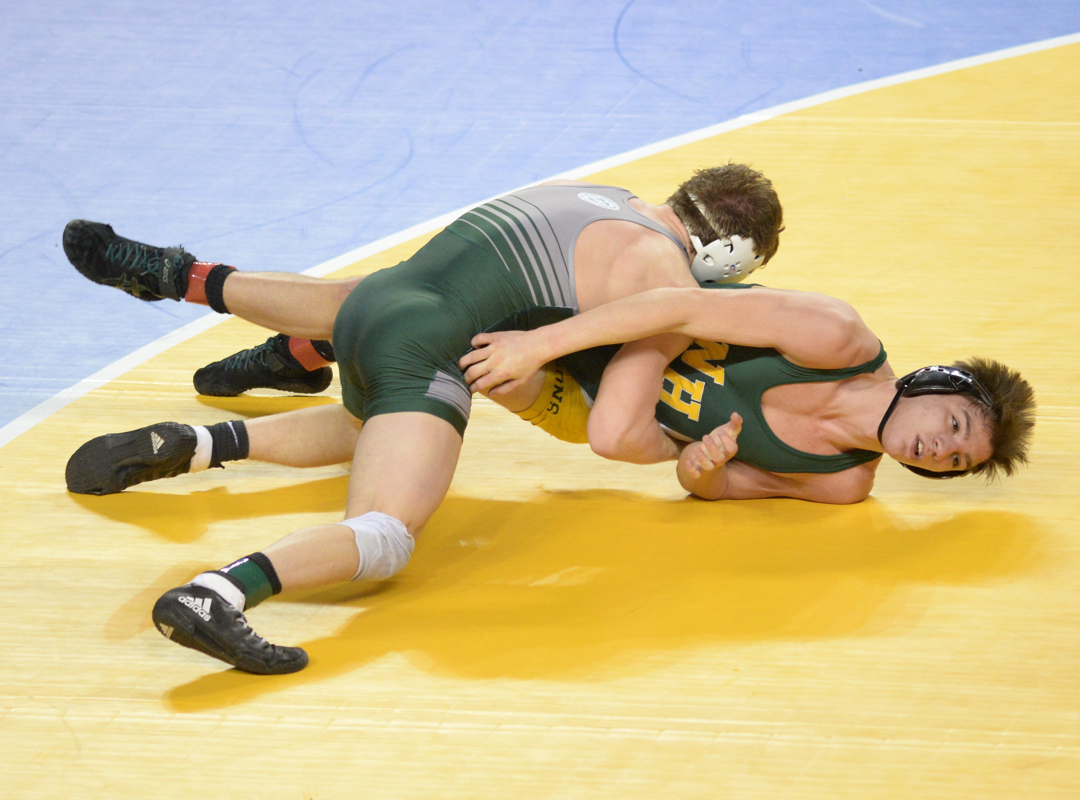 North Hunterdon's Michael Wilson wrestles DePaul's Connor O`Neil in a 160-pound quarterfinal bout during the NJSIAA Individual Wrestling Championships at Boardwalk Hall in Atlantic City, Friday, March 1, 2019.