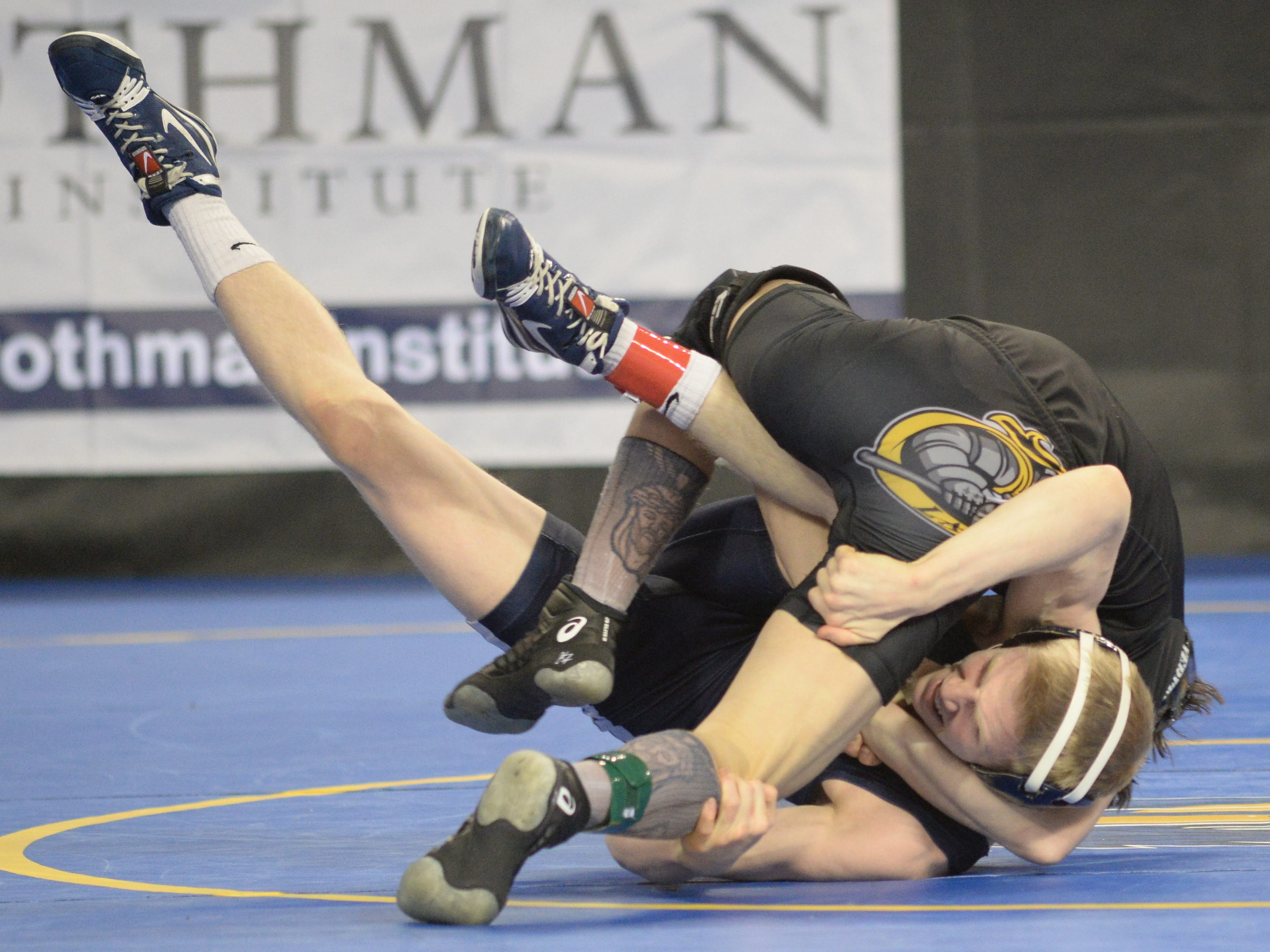 Pingry's  Brandon Spellman wrestles St. John Vianney's Dean Peterson in a 113-pound quarterfinal bout during the NJSIAA Individual Wrestling Championships at Boardwalk Hall in Atlantic City, Friday, March 1, 2019.