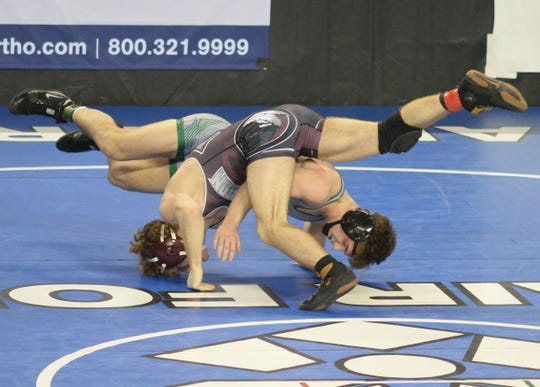 South Plainfield's Joe Sacco wrestles Newton's Wyatt McCarthy  in a 145-pound quarterfinal bout during the NJSIAA Individual Wrestling Championships at Boardwalk Hall in Atlantic City, Friday, March 1, 2019.