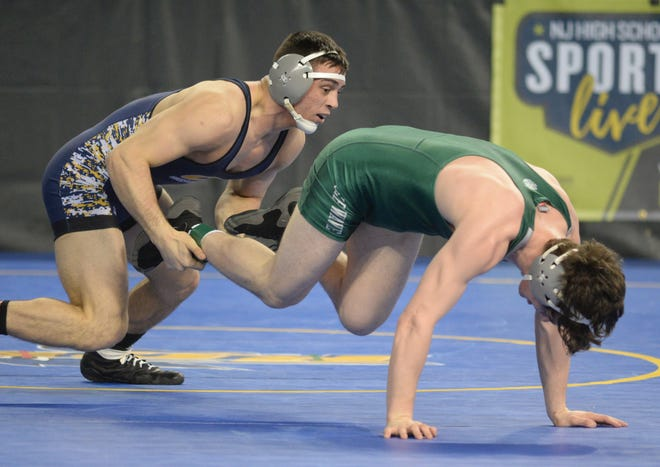 Colonia's John Poznanski  wrestles Delbarton's Kieran Calvetti in a 182-pound quarterfinal bout during the NJSIAA Individual Wrestling Championships at Boardwalk Hall in Atlantic City, Friday, March 1, 2019.