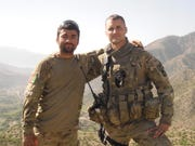 Interpreter Nabi Mohammadi, left, stands with Iowa National Guard Lt. Pat Hendrickson in Afghanistan during the Iowa Guard's 2010-11 deployment there.