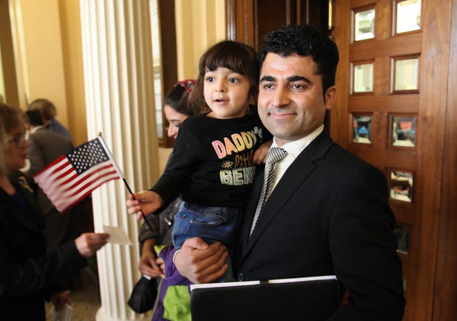 Nabi Mohammadi and his daughter, Sarah, 3, at his U.S. citizenship ceremony March 1, 2019, at the federal courthouse in Des Moines, Iowa.