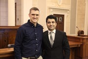 Former Iowa National Guard Sgt. Dalton Jacobus, left, helped Afghan interpreter Nabi Mohammadi gain a visa to move to the United States. Jacobus was one of several Iowa soldiers who attended Mohammadi's citizenship ceremony at the federal courthouse in Des Moines on March 1, 2019.