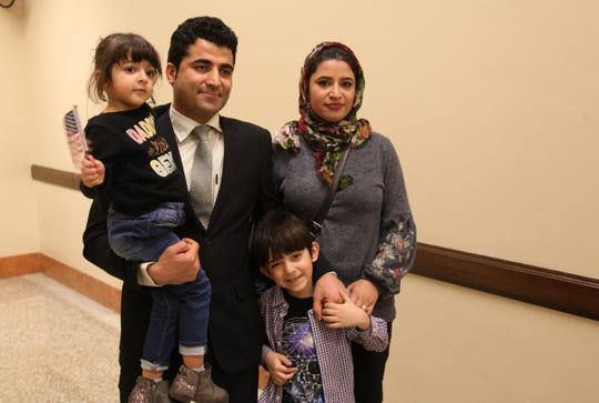 Nabi and Sanam Mohammadi, their daughter, Sarah, and their son, Arman, at the federal courthouse in Des Moines, where Nabi took the citizenship oath on March 1, 2019.