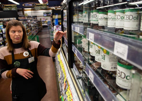 Lauren Wiese, a nutrition specialist and assistant manager at Better Health Market in Novi, shows a display of a variety of products using CBD Wednesday, Feb. 27, 2019.