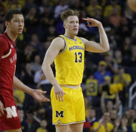 Michigan's Ignas Brazdeikis celebrates a 3-pointer against Nebraska on Thursday at Crisler Center.