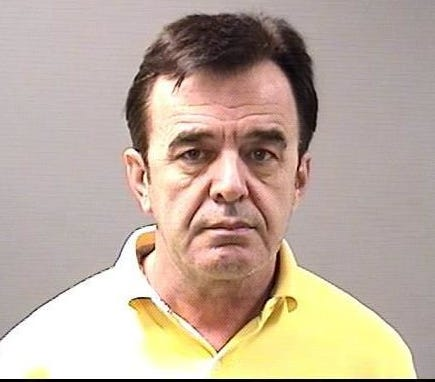 Leka Gjokaj is accused of running an illegal dental practice out of his home in Clinton Township.