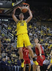 Jon Teske dunks against Nebraska during the first half Thursday at the Crisler Center.