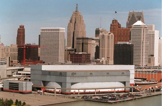 Joe Louis Arena is in the foreground with the skyline of Detroit in the background.