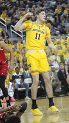 Michigan's Colin Castleton, after scoring against Nebraska in the second half Thursday, Feb. 28, 2019 at Crisler Center in Ann Arbor.