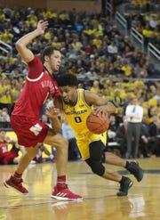 Michigan's David DeJulius drives against Nebraska's Amir Harris during the second half Thursday, Feb. 28, 2019 at Crisler Center in Ann Arbor.