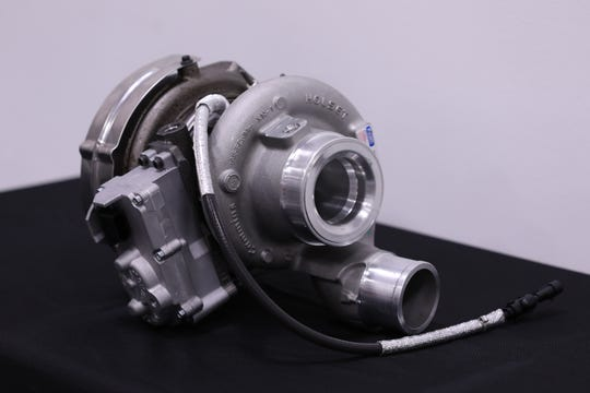 A turbocharger compresses air entering the Cummins 6.7L diesel engine.