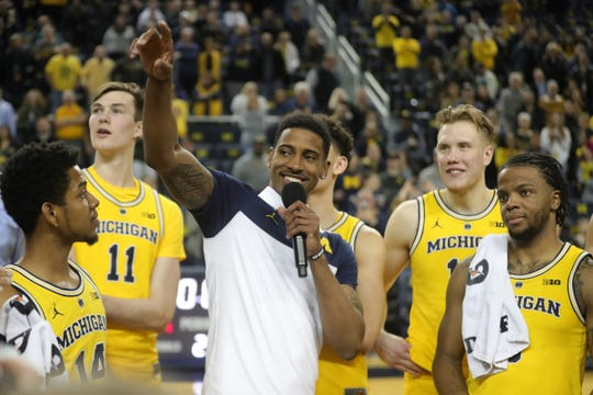 Michigan guard Charles Matthews talks to fans after the 82-53 win against Nebraska, Thursday, Feb. 28, 2019 at Crisler Center in Ann Arbor.