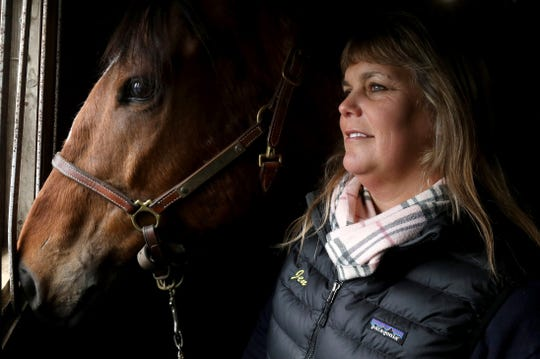 Jennifer Blades, the owner and operator of Willowbrooke Farms in Plymouth poses for a portrait with Warrior Inside, a former race horse on Tuesday, February 5, 2019. The farm caters towards retired race horses enrolled in the Canter USA program which rehabs, retrains and finds new homes for thoroughbreds who leave racing at young ages when they become injured or are not fast enough to win.