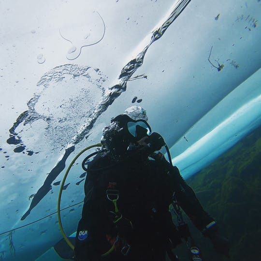 Chris Roxburgh, a 39-year-old ice diver from Traverse City, beneath the surface of West Grand Traverse Bay in February of 2018